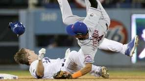 New York Mets shortstop Ruben Tejada, goes over