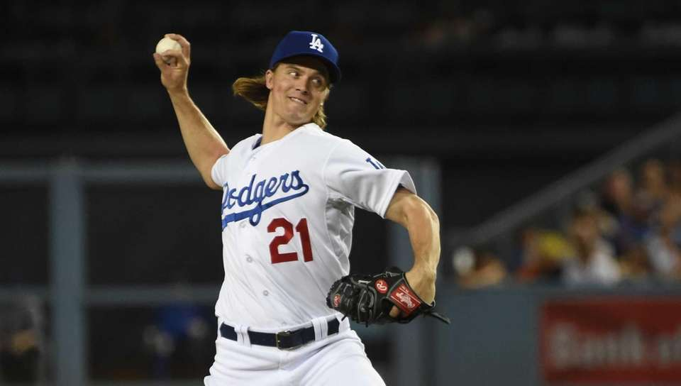 Los Angeles Dodgers pitcher Zack Greinke throws in