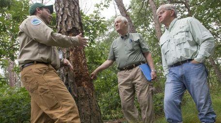 DEC forester John Wernet, left, assemblymen Steve Englebright