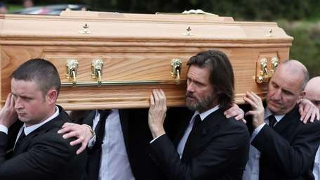 Actor Jim Carrey helps carry the coffin of