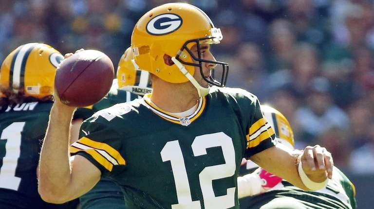 Green Bay Packers' Aaron Rodgers drops back during