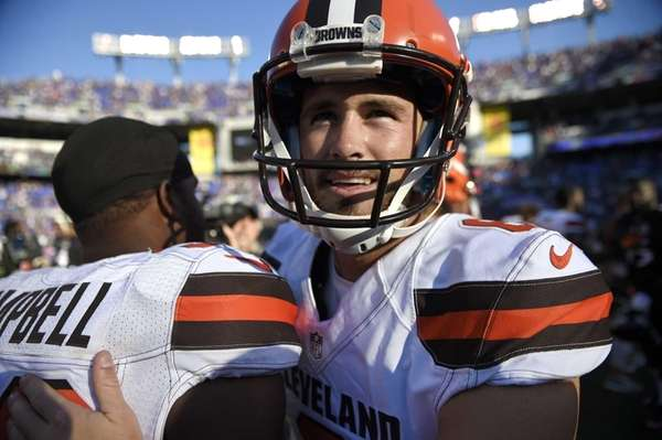 Cleveland Browns kicker Travis Coons, right, celebrates with