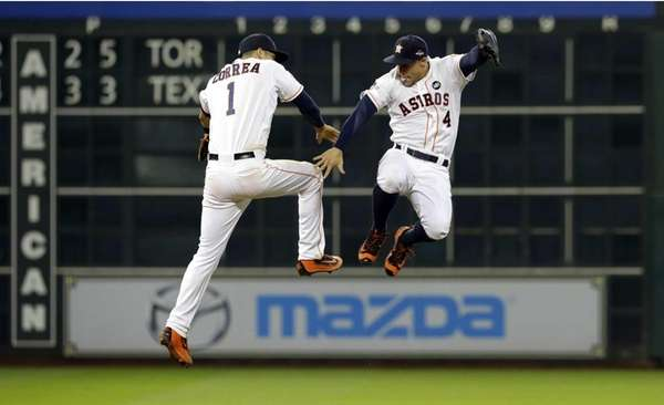 Houston Astros' Carlos Correa (1) and George Springer
