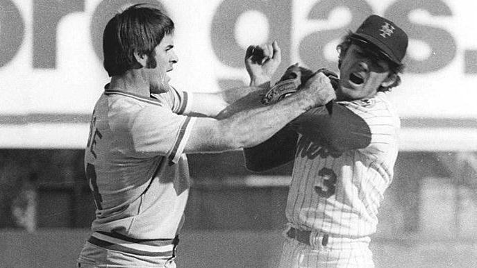 Pete Rose, left, of the Cincinnati Reds, swings