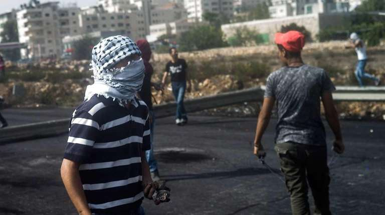 Palestinian youths clash with Israeli security forces on