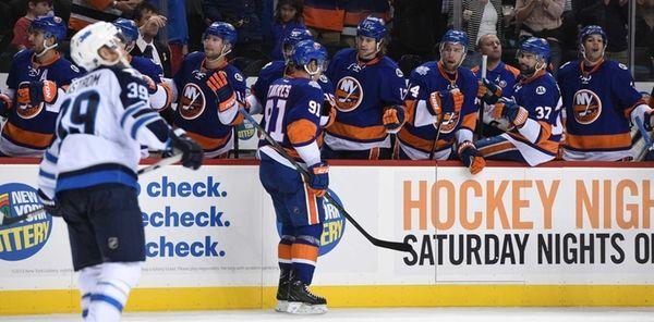 New York Islanders center John Tavares is congratulated