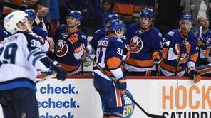 New York Islanders center John Tavares is congratulated