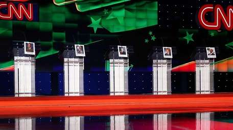 Photographs of Democratic Presidential candidates hang on their