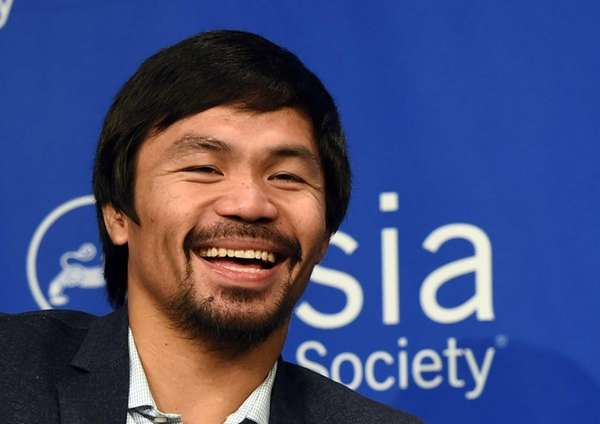 Boxer Manny Pacquiao speaks to reporters after touring