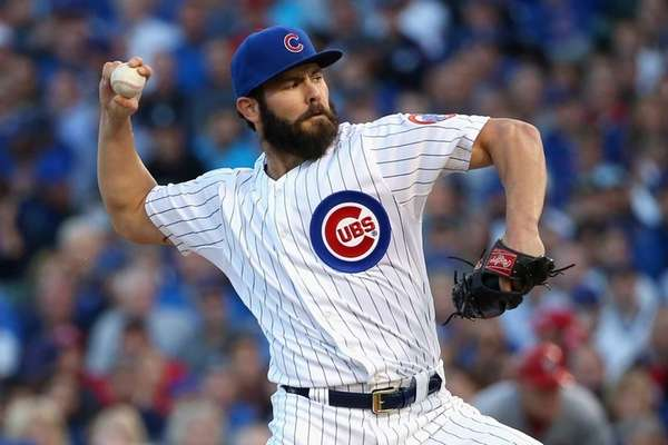 Jake Arrieta #49 of the Chicago Cubs throws
