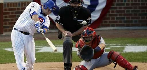 Chicago Cubs' Kyle Schwarber (12) hits a home