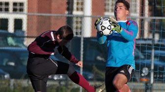 Mattituck goalie James Jacobs #25 makes a save