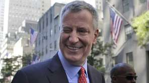 New York City Mayor Bill de Blasio winks