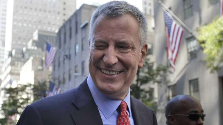 New York City Mayor Bill de Blasio winks