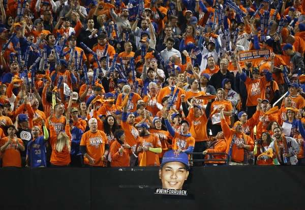 New York Mets fans display a sign supporting