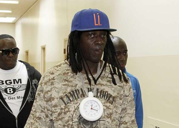 Flavor Flav leaves the Nassau County courthouse in