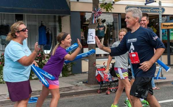 Suffolk County Executive Steven Bellone high-fives with Sarah