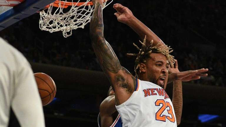 New York Knicks forward Derrick Williams scores on