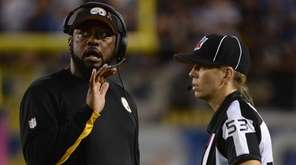 Pittsburgh Steelers head coach Mike Tomlin talks to