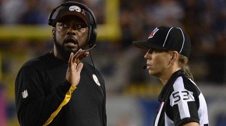 Pittsburgh Steelers head coach Mike Tomlin talks to
