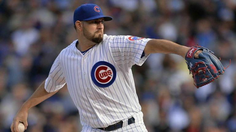 Chicago Cubs starting pitcher Jason Hammel throws during