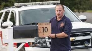 Montauk Fire Department Chief Joseph Lenahan holds a
