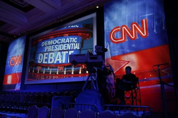 A camera operator waits in the debate hall