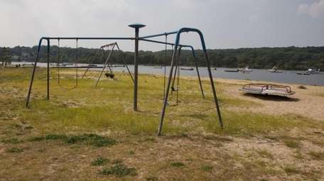 Swings sit empty at Scudder Park in Northport,