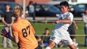 Brentwood's Alejandro Callejas scores a goal past Commack's