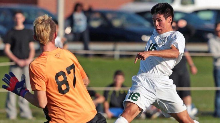 Brentwood's Alejandro Callejas scores a goal past Commack's