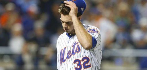 New York Mets starting pitcher Steven Matz walks