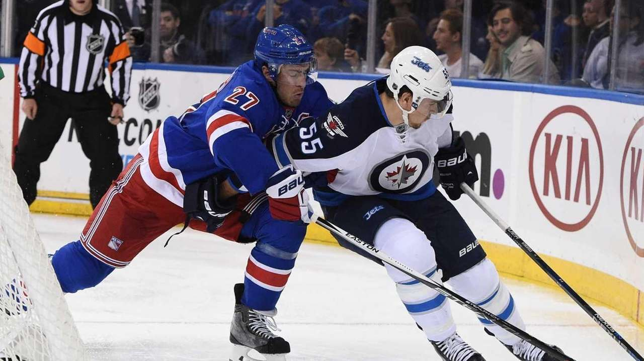 New York Rangers defenseman Ryan McDonagh guards Winnipeg
