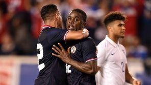 Costa Rica's forward Joel Nathaniel (C) celebrates with