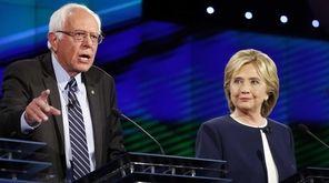Hillary Rodham Clinton, right, looks on as Sen.