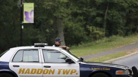 A police officer blocks a street near Cooper