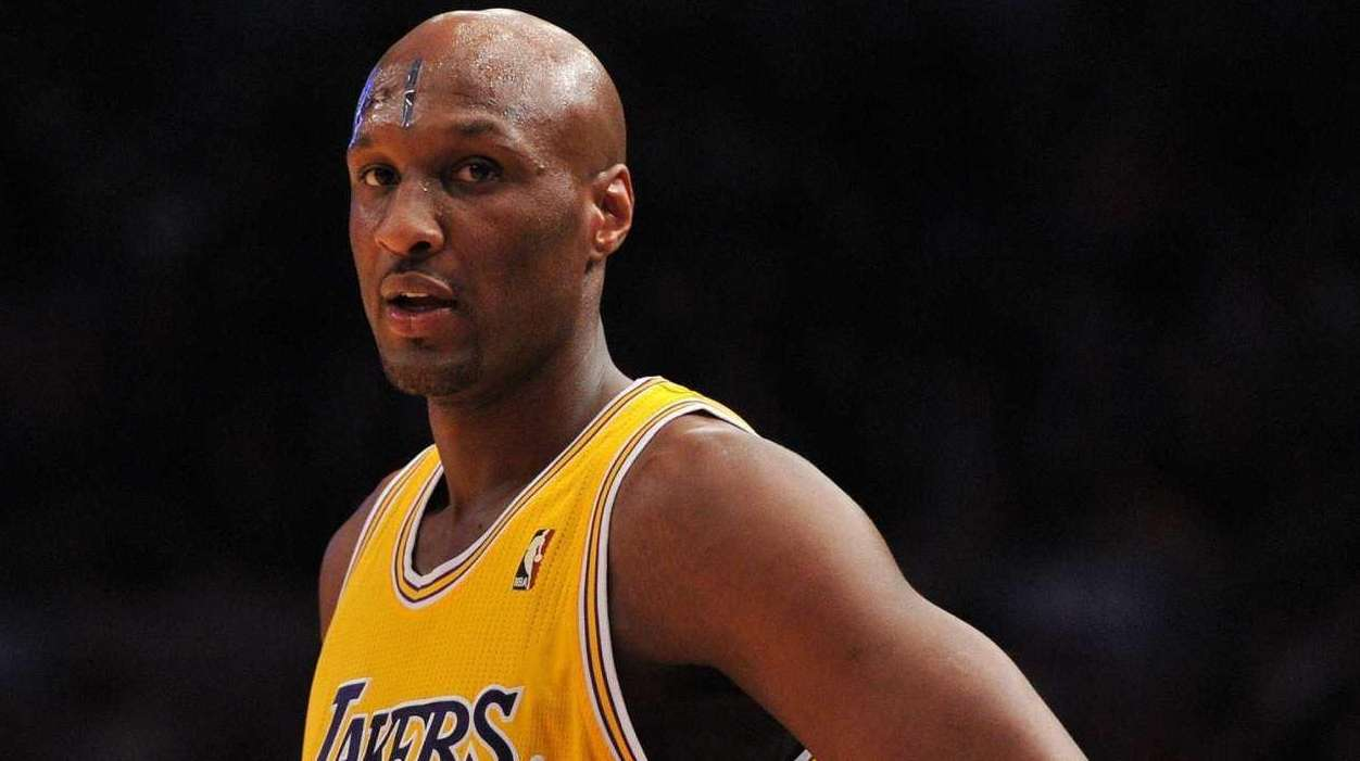 Los Angeles Lakers forward Lamar Odom looks at
