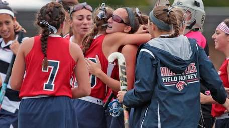 Arianna Esposito of Miller Place is congratulated by