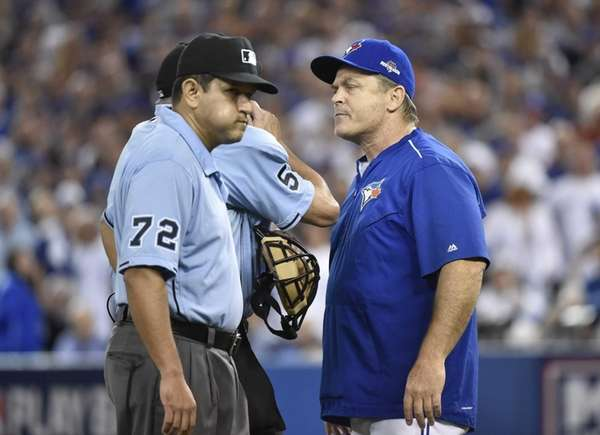 Toronto Blue Jays manager John Gibbons argues with