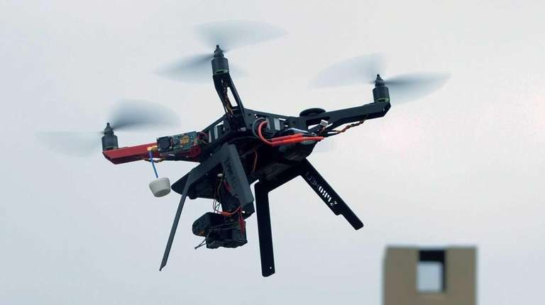 A drone with a high definition camera flies