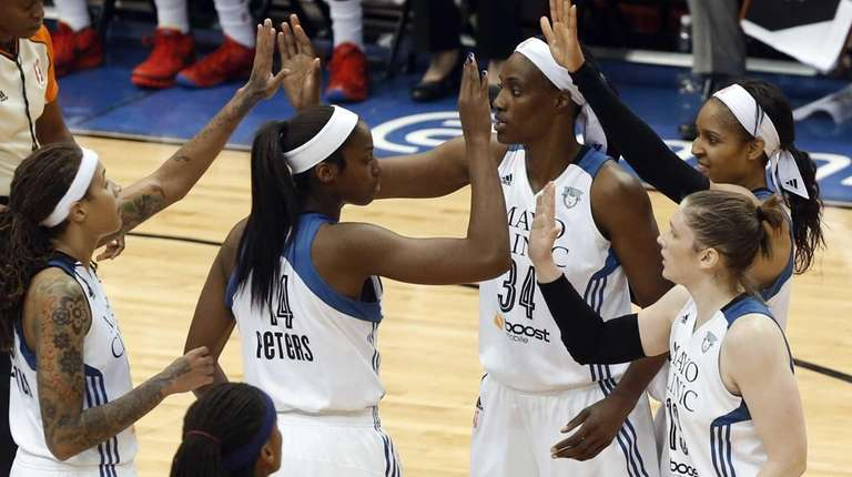 Minnesota Lynx players celebrate a play against the