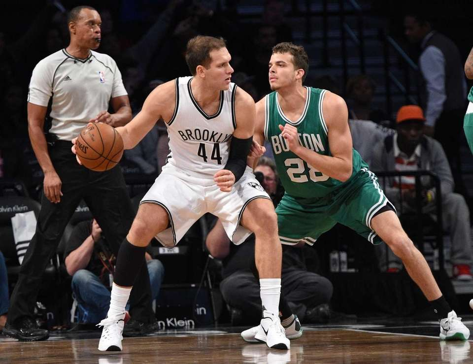 Brooklyn Nets guard Bojan Bogdanovic is defended by