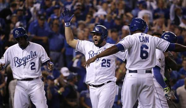 Kansas City Royals' Kendrys Morales celebrates with teammates