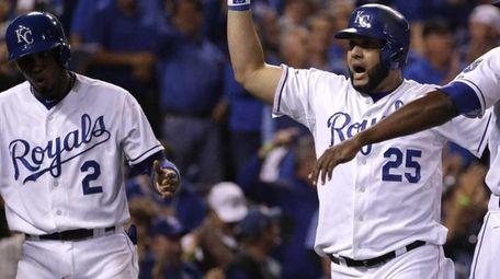 Kansas City Royals' Kendrys Morales celebrates with teammates