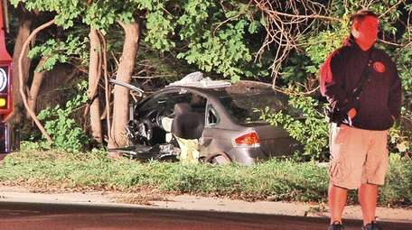 Officials at the scene of a crash involving