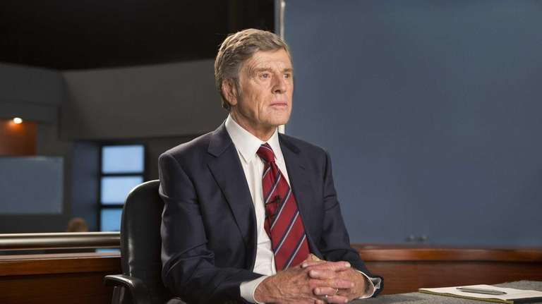 Robert Redford portrays Dan Rather in a scene