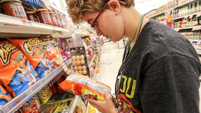 Aliya Miccio, 21, participates in a biweekly shopping
