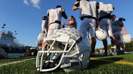 A new helmet is pictured on the sideline
