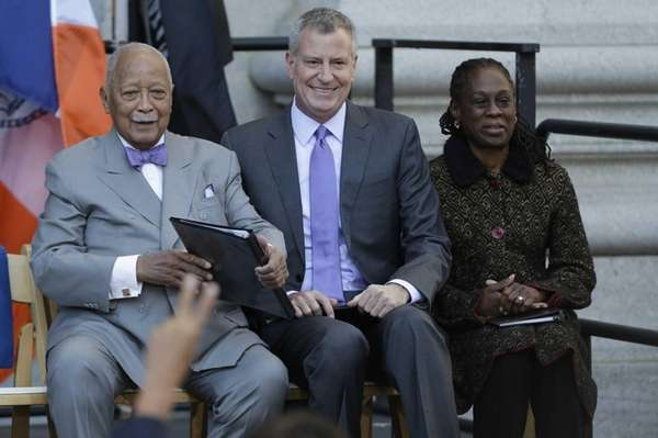 Former New York City Mayor David Dinkins, left,