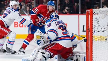 Tomas Fleischmann of the Montreal Canadiens shoots past