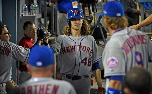 New York Mets pitcher Jacob deGrom is high-fived